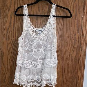 White lace blouse with fringe